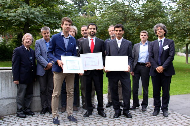 [Photo]Winners of the Awards 2014 together with the jury: Front (left to right): Štěpán Mráček, Marcos Martinez Diaz, Laurent El Shafey - Back (left to right): Jim Wayman, Christoph Busch, Raymond Veldhuis, Alexander Nouak, Günther Schumacher, Jean-Christophe Fondeur, Patrizio Campisi