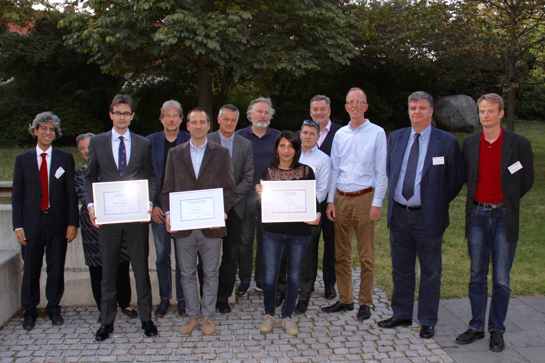 [Photo] Winners of the Awards 2015 together with the jury: (left to right): Patrizio Campisi, Dijana Petrovska Delacretaz, Mateusz Trokielewicz, Raymond Veldhuis, Javier Franco-Pedroso, Christoph Busch, Günther Schumacher, Chiara Galdi, Jean-Christophe Fondeur, Alexander Nouak, Tom Kevenaar, Javier Ortega Garcia and Lars Christensen