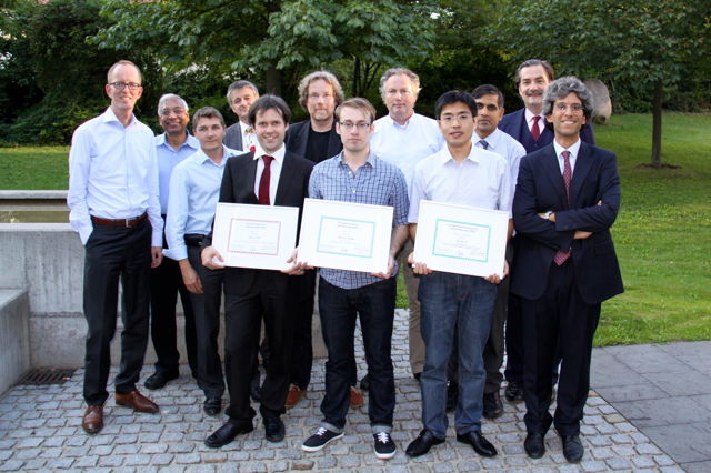 [Photo] Winners of the Awards 2013 together with the jury: Front (left to right): Tom Kevenaar, Jean-Christophe Fondeur, Peter Wild, Finnian Kelly, Huiibin Li, Patrizio Campisi – Back (left to right): Anil Jain, Christoph Busch, Raymond Veldhuis, Günther Schumacher, Ajay Kumar, Alexander Nouak