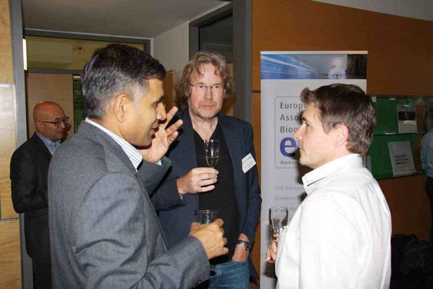 [Photo] Impressions from the reception: Ajay Kumar in discussion with Jean-Christophe Fondeur and Raymond Veldhuis