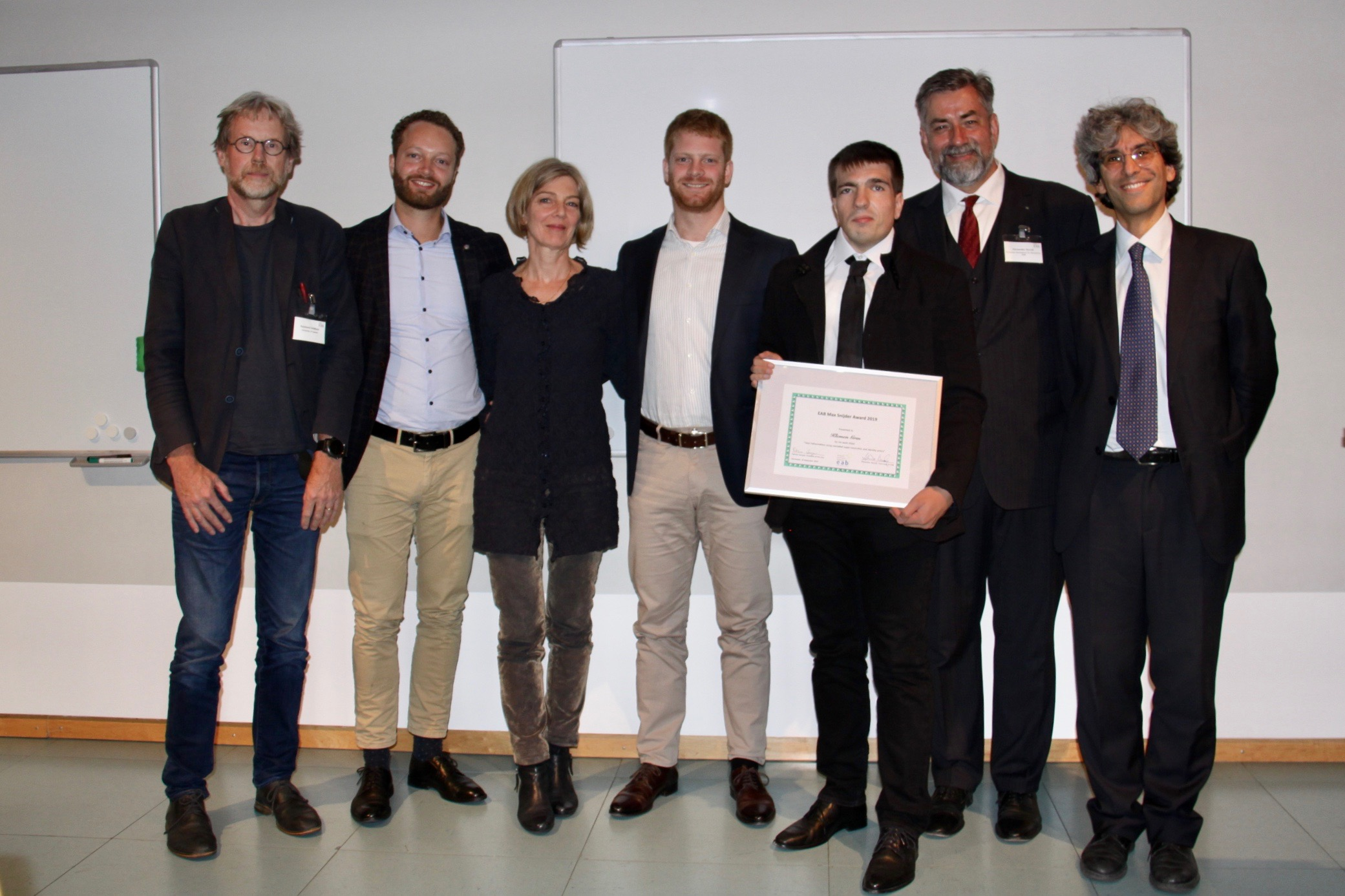 [Photo] Jury member Prof Raymond Veldhuis, Arthur Snijder, Carine Wouters, Caspar Snijder, the award winner Dr Klemen Grm together with the EAB chairman Alexander Nouak and the EAB award chair Prof Patrizio Campisi